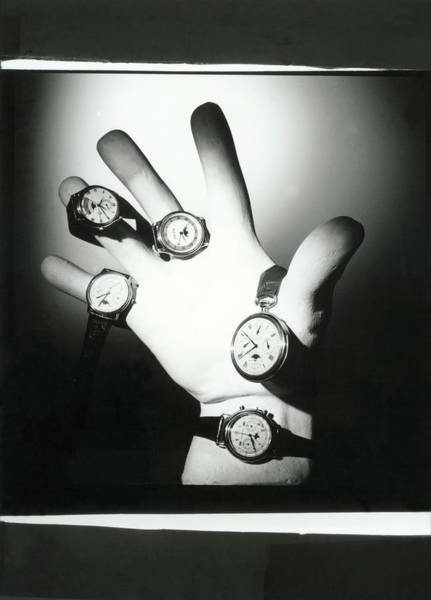 Copy Photograph - A Hand Holding A Group Of Watches by Horst P. Horst