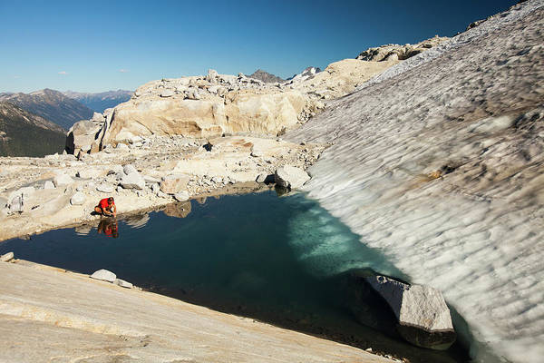 Pemberton Photograph - A Hiker Stops Tos Wash His Hands by Christopher Kimmel