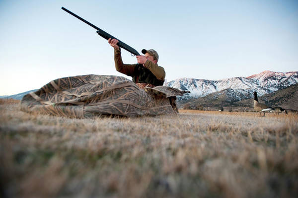 Wall Art - Photograph - A Hunter Aims His Rifle From A Blind by Corey Rich
