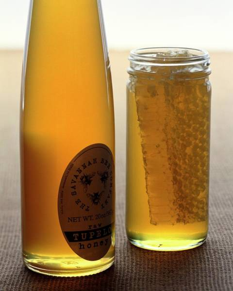 Bees Photograph - A Jar And Bottle Of Honey by Romulo Yanes