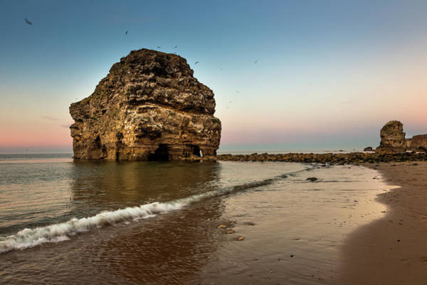 Wall Art - Photograph - A Large Rock Formation On The Coast by John Short