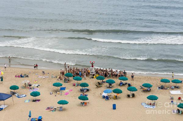 A Lifeguard Gives A Safety Briefing To Beachgoers In Ocean City Maryland Art Print