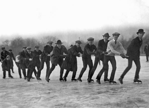 1921 Photograph - A Line Of Ice Skaters by Underwood Archives