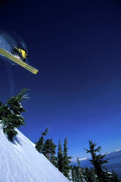 Wall Art - Photograph - A Male Alpine Skier Jumps Off A Cliff by Corey Rich
