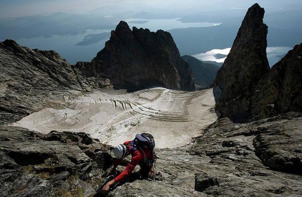 Mount Moran Photograph - A Male Climber Climbs Mt. Moran by David Stubbs