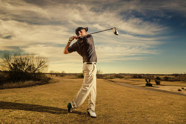 Golf Photograph - A Male Golfer Swinging Golf Club At by Wild Horse Photography
