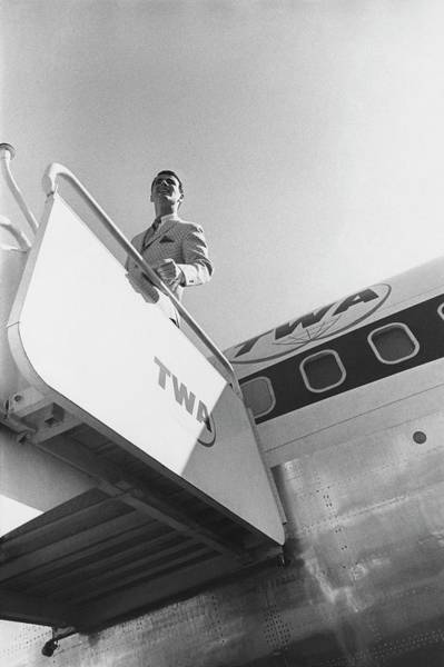 Polka Dots Photograph - A Male Model Disembarking A Twa Boeing 707 Plane by Leonard Nones