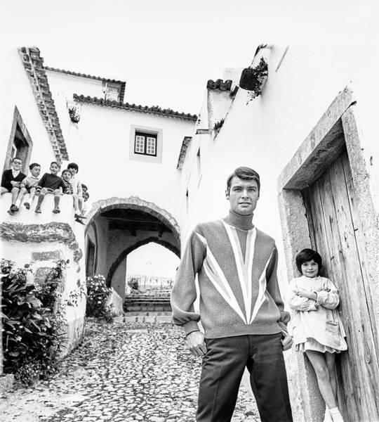 Iberian Peninsula Photograph - A Male Model Posing While A Group Of Children by Leonard Nones