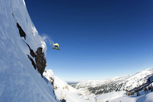 Wall Art - Photograph - A Male Snowboarder Rides Off A 50 Foot by Mark Fisher