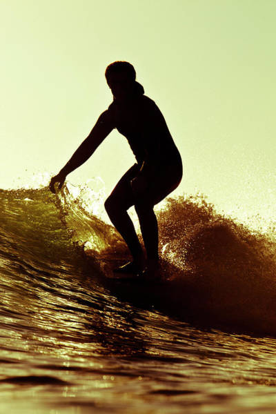 Wall Art - Photograph - A Male Surfer Rides A Longboard by Kyle Sparks