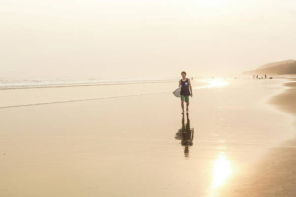 Wall Art - Photograph - A Male Surfer Walking On The Beach by Alexandra Simone