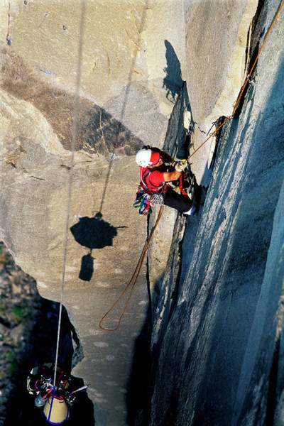 Hanging Rock Photograph - A Man Aid Climbing by Corey Rich