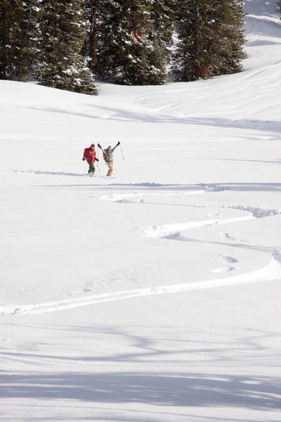 A Man And Woman Backcountry Skiing Art Print