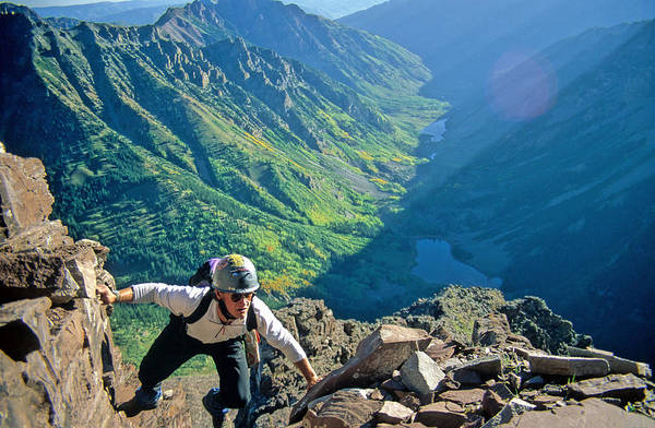 Fourteener Photograph - A Man Climbs To The Summit Of Maroon by Abrahm Lustgarten