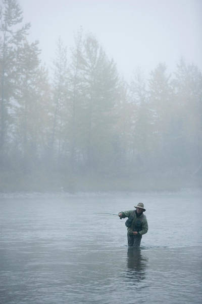 Wall Art - Photograph - A Man Fly-fishing On Elk River, Bc by Henry Georgi