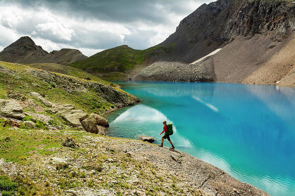 Wall Art - Photograph - A Man Hiking Past A Blue Lake, San Juan by Kennan Harvey