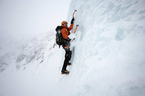New Years Day Photograph - A Man Ice Climbing On Tuckermans Ravine by Jose Azel