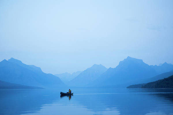 Canoe Photograph - A Man In A Canoe by Jordan Siemens