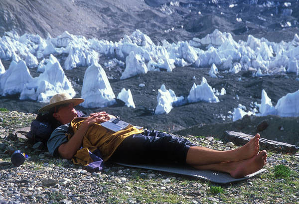 Wall Art - Photograph - A Man Naps On A Glacier With His Hat by Jimmy Chin