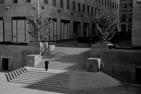 Plaza Photograph - A Man On The Steps At Rockefeller Plaza by Remie Lohse