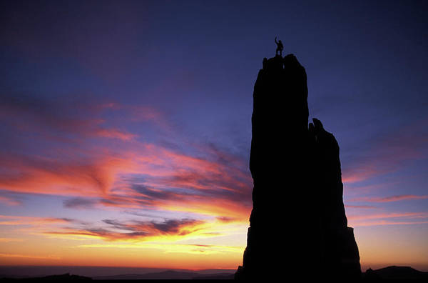 Alpine Meadows Photograph - A Man On Top Of A Rock Pinnacle by Corey Rich