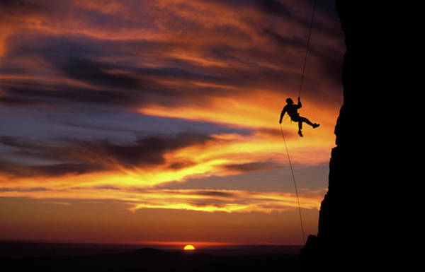 Wall Art - Photograph - A Man Rappelling Off A Rock Pinnacle by Corey Rich