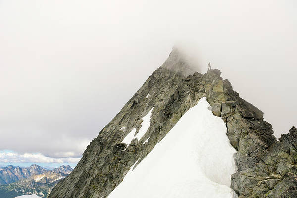 Silhoutte Photograph - A Man Rock Climbing In North Cascades by Kennan Harvey