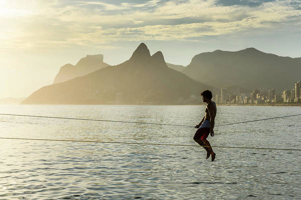 Wall Art - Photograph - A Man Sitting On A Slackline by Vitor Marigo