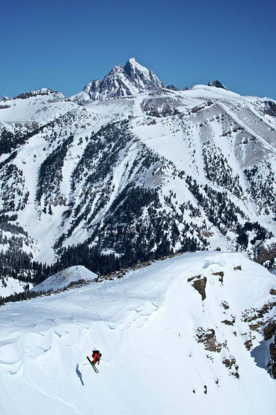 Wall Art - Photograph - A Man Skiing A Steep Slope by Derek DiLuzio