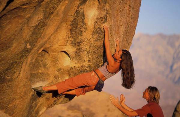 Wall Art - Photograph - A Man Spots A Female Rock Climber On An by Corey Rich