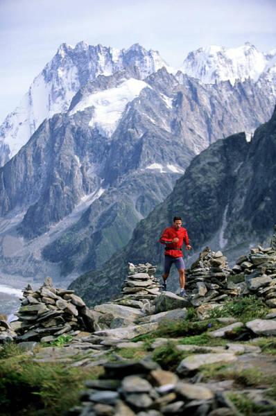 Chamonix Wall Art - Photograph - A Man Trail Runs In Chamonix, France by Scott Markewitz