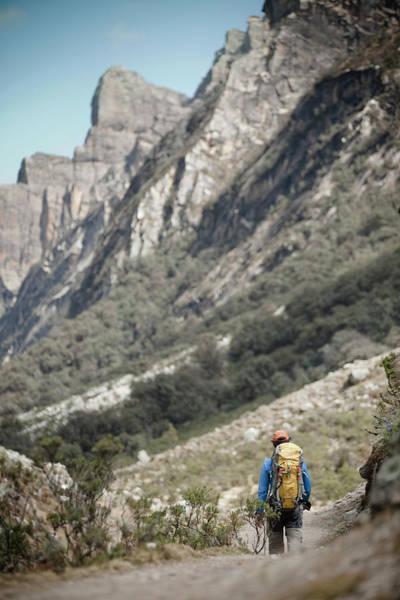 Wall Art - Photograph - A Man Trekking In The Quebrada Ishinca by Marcos Ferro