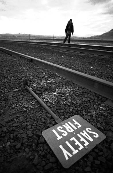 Wall Art - Photograph - A Man Walking Down Railroad Tracks by Corey Rich
