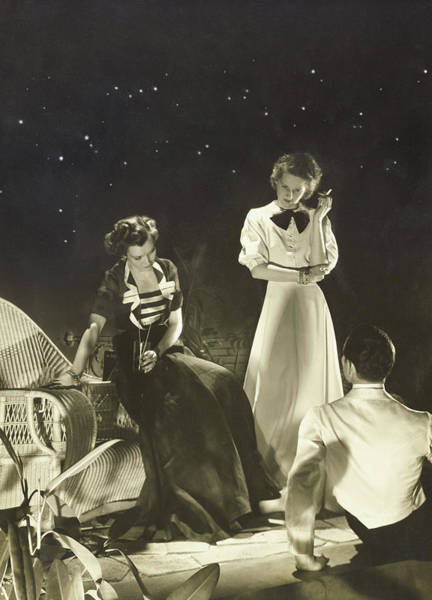 Wicker Chair Photograph - A Man With Female Models In Boucheron Jewels by Horst P. Horst