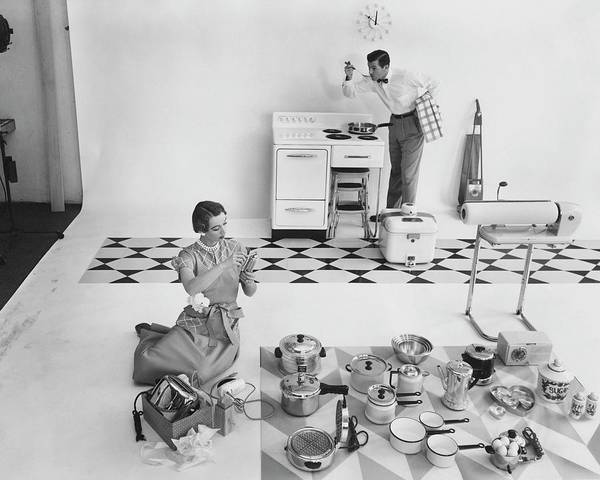 Home Accessories Photograph - A Married Couple With Kitchen Appliances by Herbert Matter