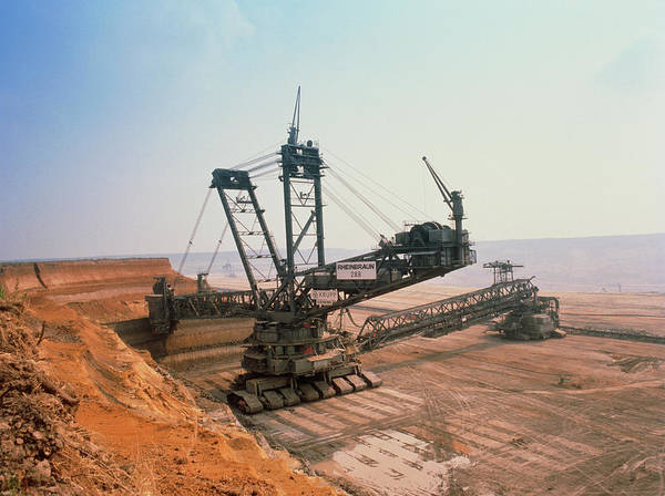 Coal Mining Photograph - A Massive Bucket Wheel Excavator by Tony Craddock/science Photo Library