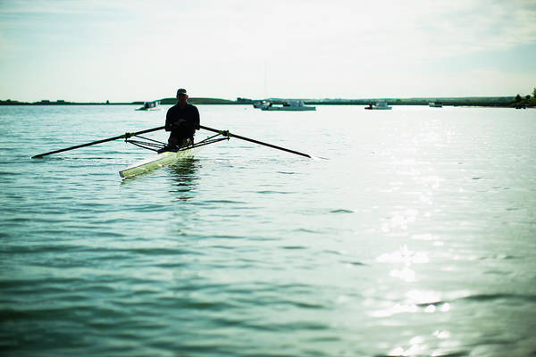 Senior Adult Photograph - A Mature Man In A Rowing Boat On The by Mint Images/ Jamie Kripke