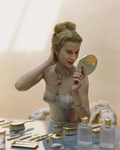 Make Up Photograph - A Model At A Dressing Table by John Rawlings