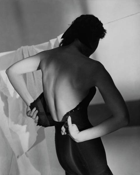 Wall Art - Photograph - A Model Fastening Her Brassiere by Horst P. Horst