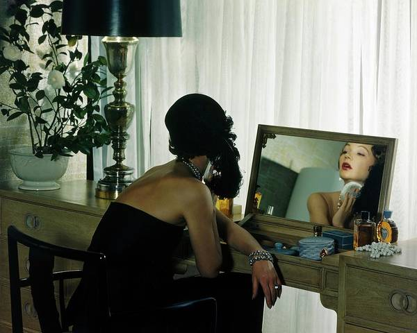 Mirror Photograph - A Model Getting Ready In A Mirror by Herbert Matter