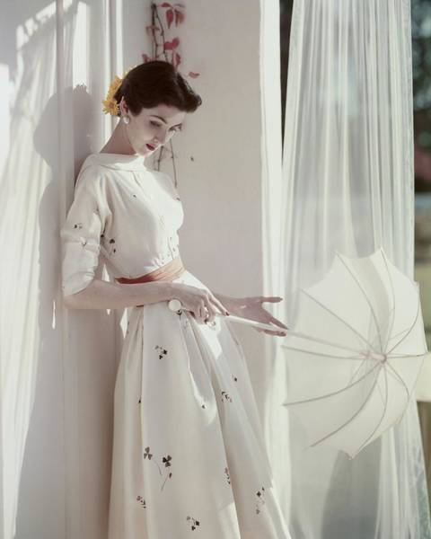 Window Photograph - A Model Holding A Parasol by Horst P. Horst