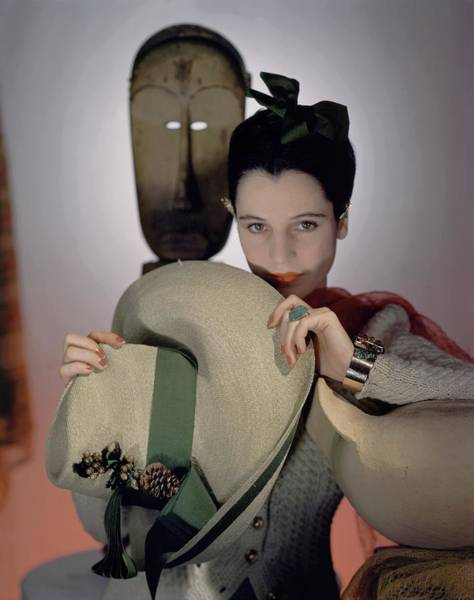 Visual Arts Photograph - A Model Holding A Sun Hat by Horst P. Horst