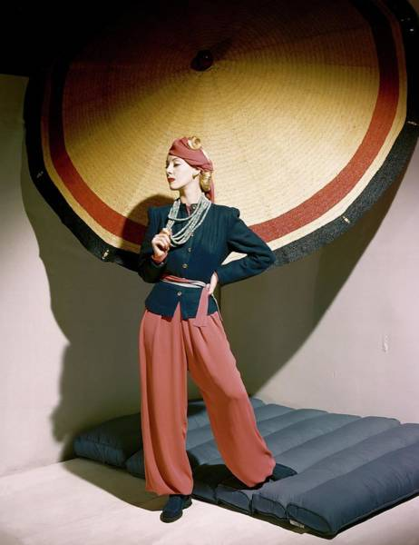 Traditional Clothing Photograph - A Model Holding An Umbrella by Horst P. Horst