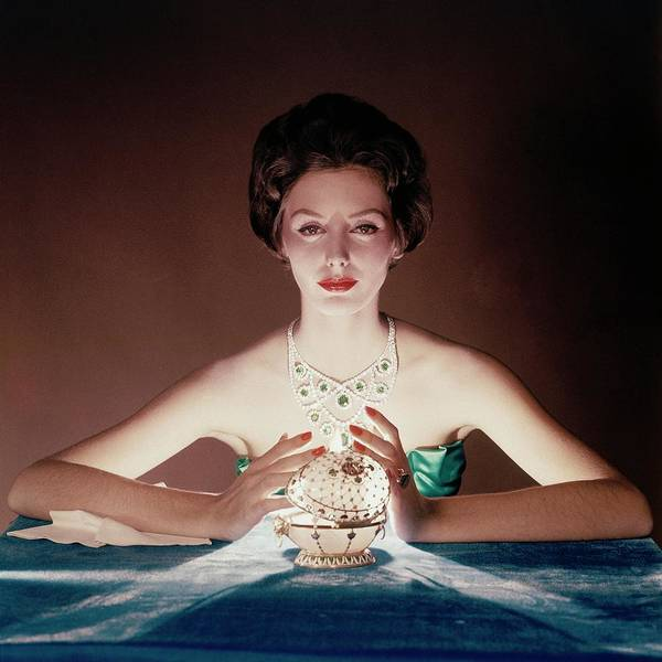 Photograph - A Model Illuminated By A Faberge Egg by John Rawlings