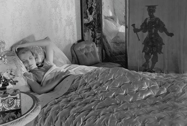 Clock Photograph - A Model In A Bed With Designer Bedding by Horst P. Horst
