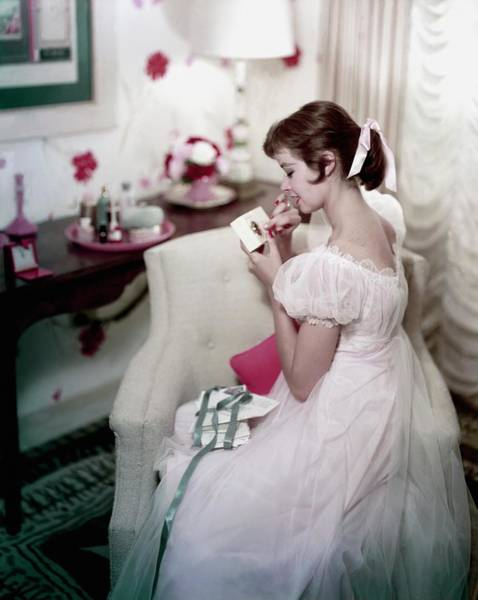 1956 Photograph - A Model In A Gown Sitting On An Armchair by Sante Forlano