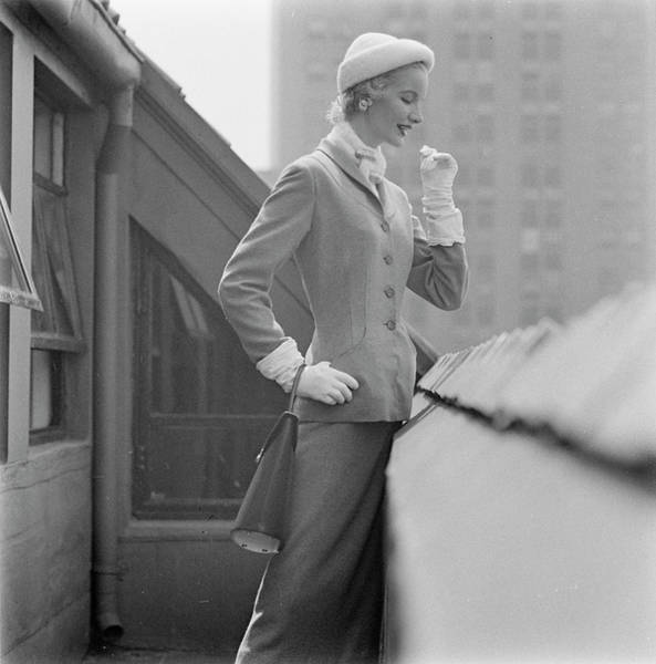 New Years Day Photograph - A Model In A Tweed Suit Standing On A New York by Richard Rutledge