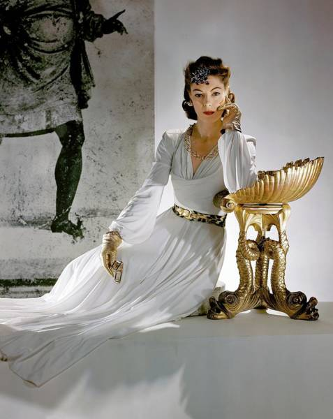 Metallic Photograph - A Model Leaning On A Gold Pedestal by Horst P. Horst