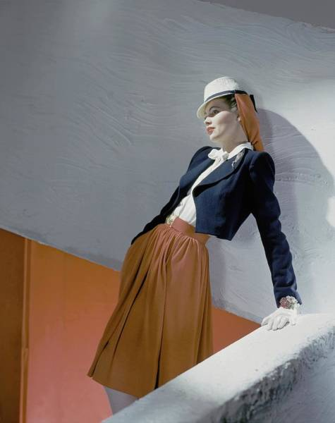 A Model Leaning On A Wall Art Print by Horst P. Horst