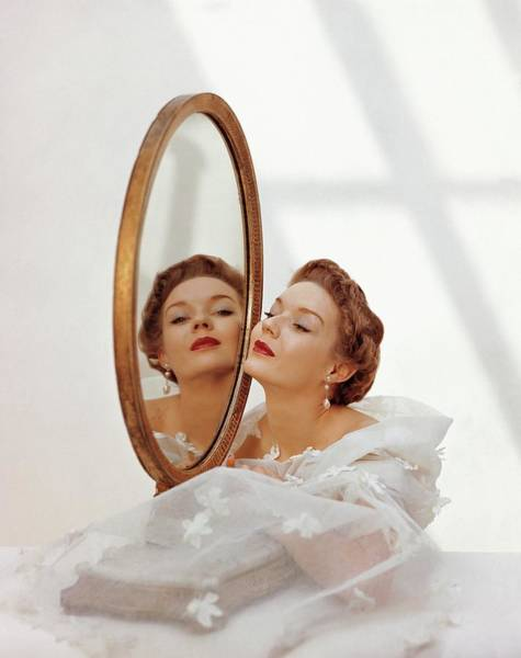 Photograph - A Model Looking Into A Mirror by John Rawlings